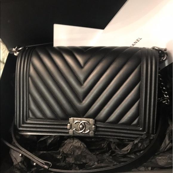 CHANEL Handbags - Authentic chanel boy chervon lambskin like new 98% 143c874661032
